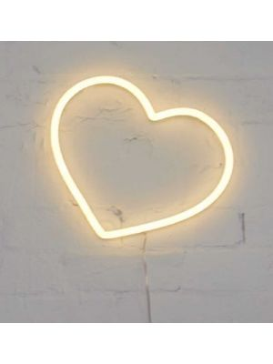 Small Neon Heart Light mounted on a brick wall