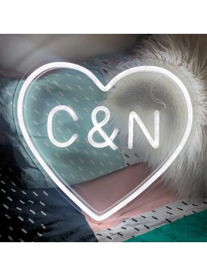 Personalised Heart Neon Sign in LED Flex with clear acrylic background, shown on a pillow - photo from CustomNeon.co.uk