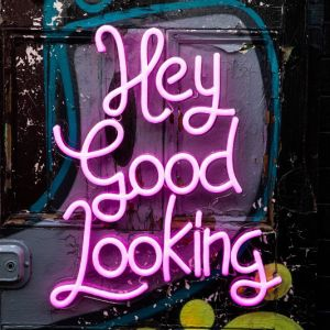 * Hey Good Looking * Pink LED Neon Wall Art on graffiti - photo from CustomNeon.com
