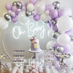 Oh Baby baby shower sign shown surrounded by balloons and cakes - photo from CustomNeon.co.uk