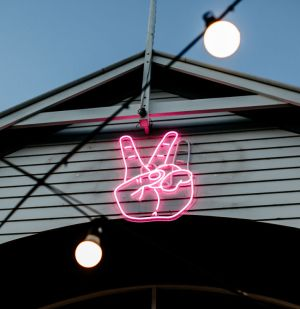 Peace Sign / Sign of the Horns Alternating Neon Sign - photos CustomNeon.com